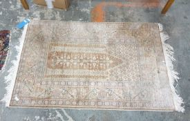 Early 20th Century Turkish prayer rug in browns, fawns, pinks and blues, on stepped border 132cm x