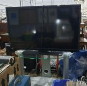 Toshiba 40 inch HD TV, model no. 40L1333DB and glass television stand