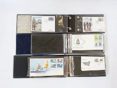 Box of miscellaneous albums, stock books, stamps andFirst Day Covers and a box of mostly modern