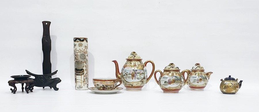 Lot 86 - Japanese Satsuma part tea service painted in gilt with figures before pavillions, in garden