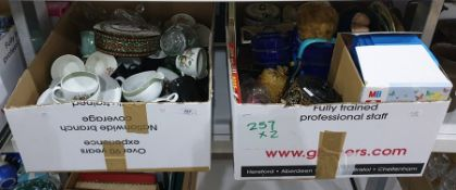 Two mixed boxes containing assortment of glass and ceramics with children's toys and books