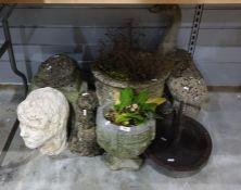 Seven composite garden planters and ornaments plus cast iron boot-scraper