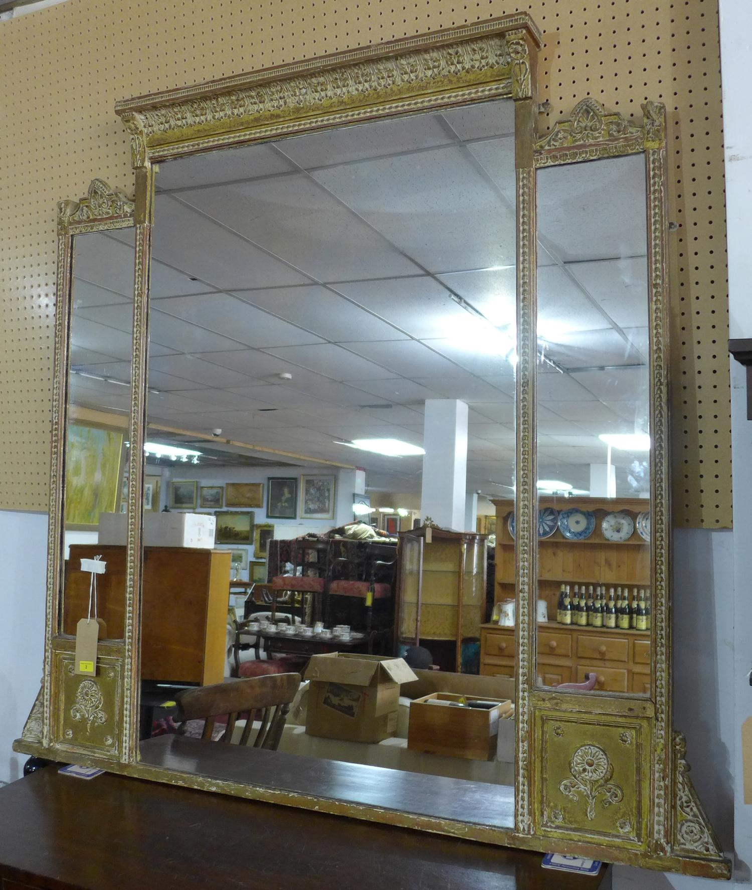 Lot 2 - A 19th century giltwood overmantle mirror, having three glass plates and floral decorated frame, H.