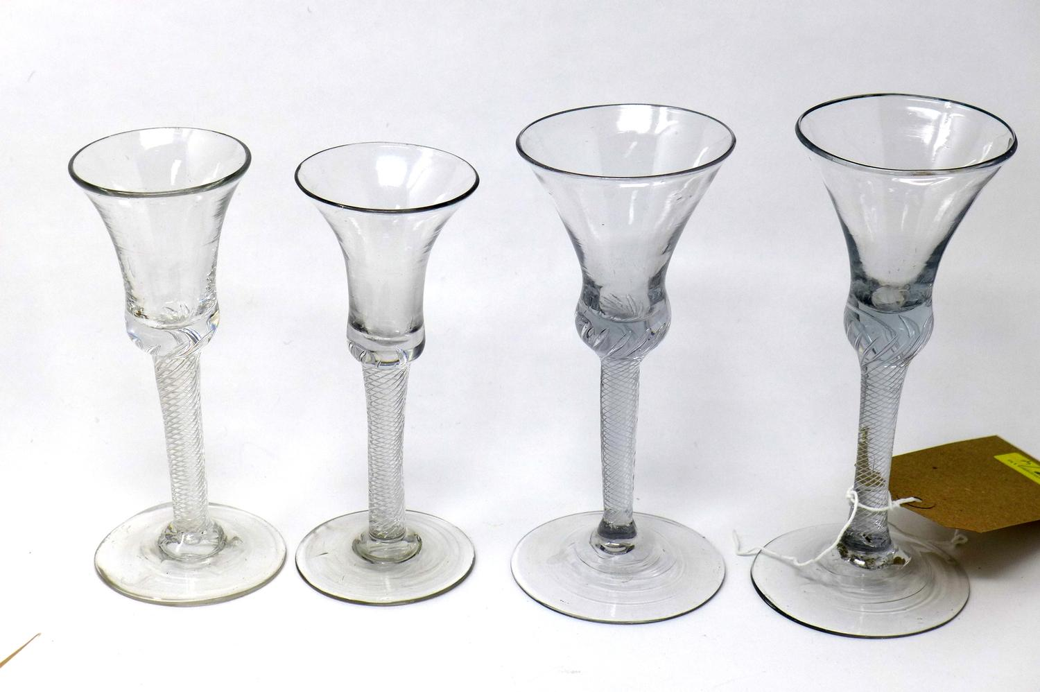 Lot 27 - Four Georgian cordial glasses, with opaque twisted stems, H.19cm (tallest)