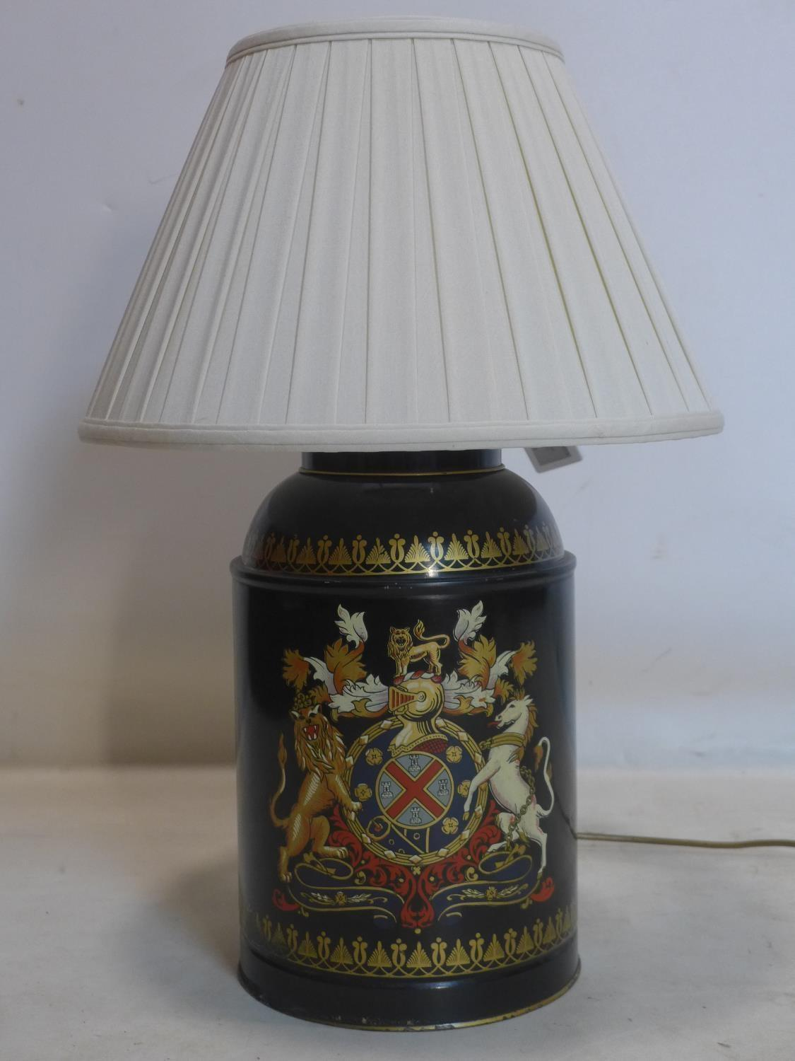 Lot 500 - A 19th tole ware tea caddy hand painted with armorial crest, converted to a lamp, H.36cm