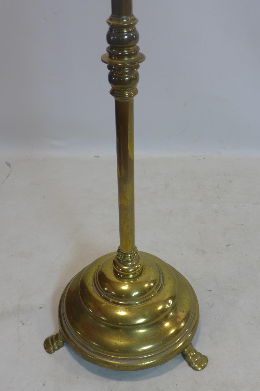 Lot 670 - A Victorian brass telescopic standard lamp
