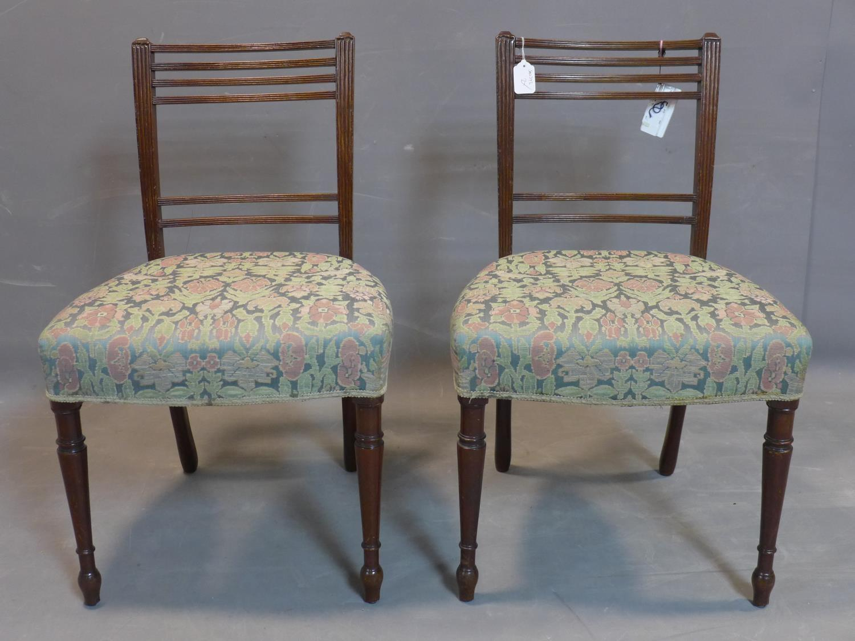 Lot 220 - A pair of Georgian mahogany dining chairs.