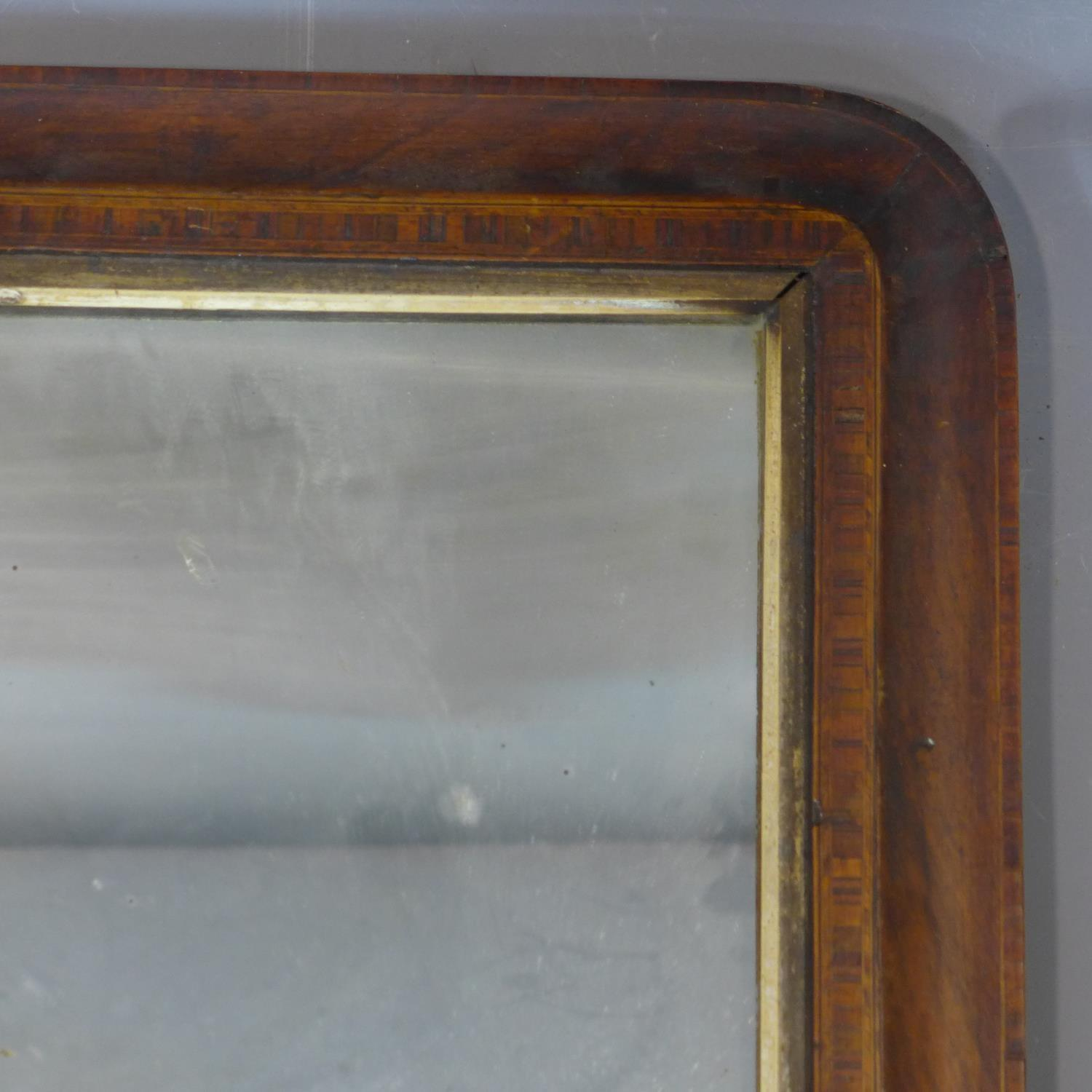 Lot 172 - An inlaid overmantle mirror, with some chips to frame, 43 x 71cm