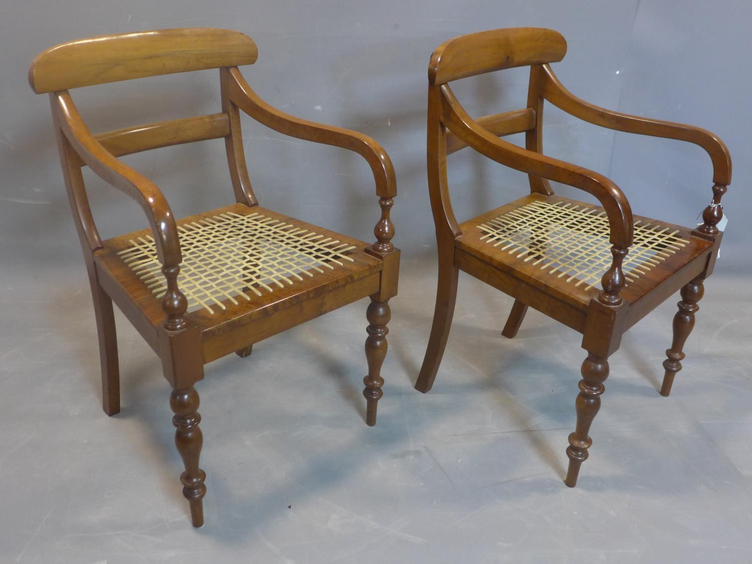 Lot 113 - A pair of 19th century mahogany scroll armchairs, on turned baluster supports, having hide cord