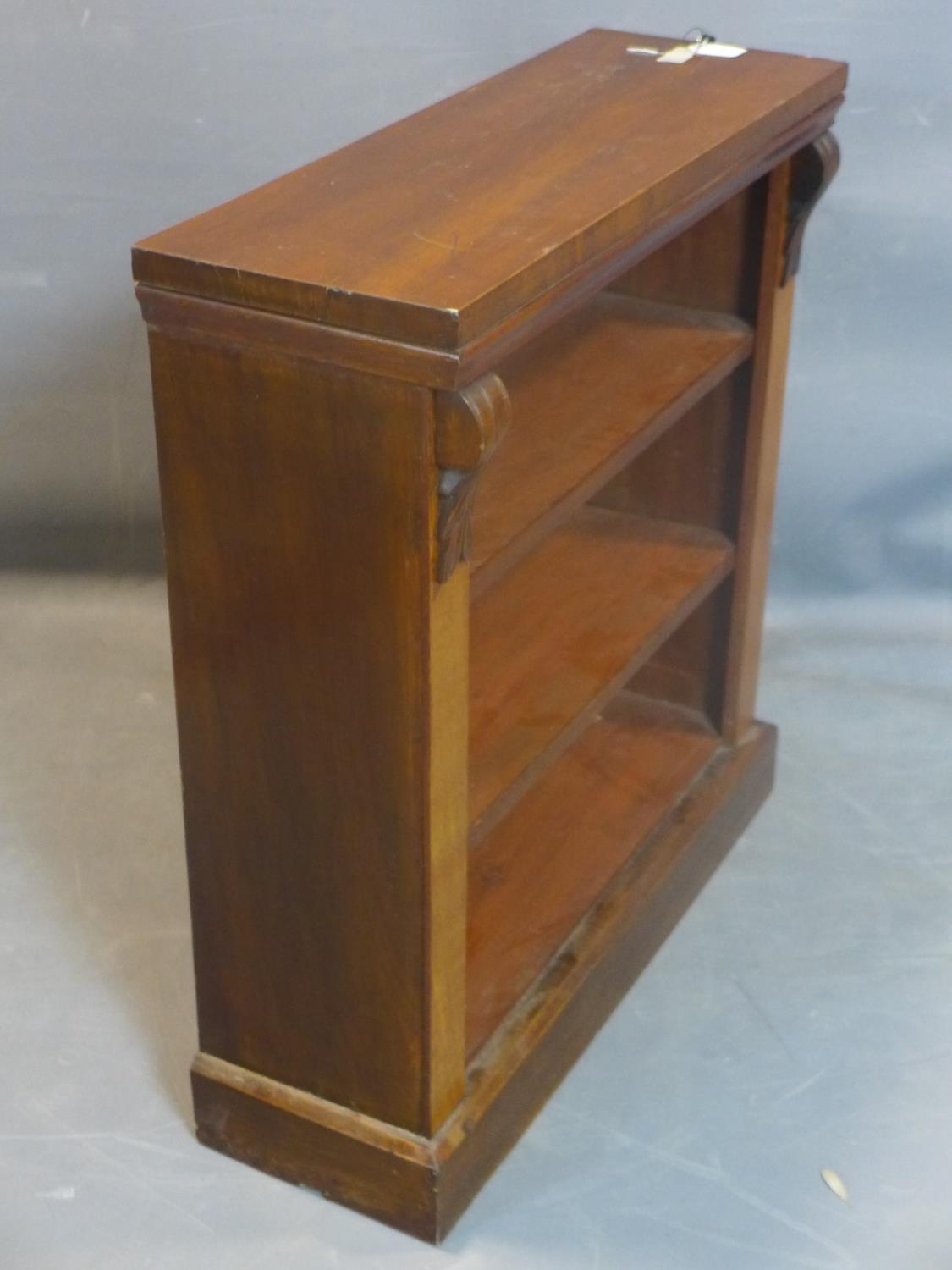 Lot 251 - A 20th century mahogany open bookcase, with two adjustable shelves, on pedestal base, H.88 W.83 D.