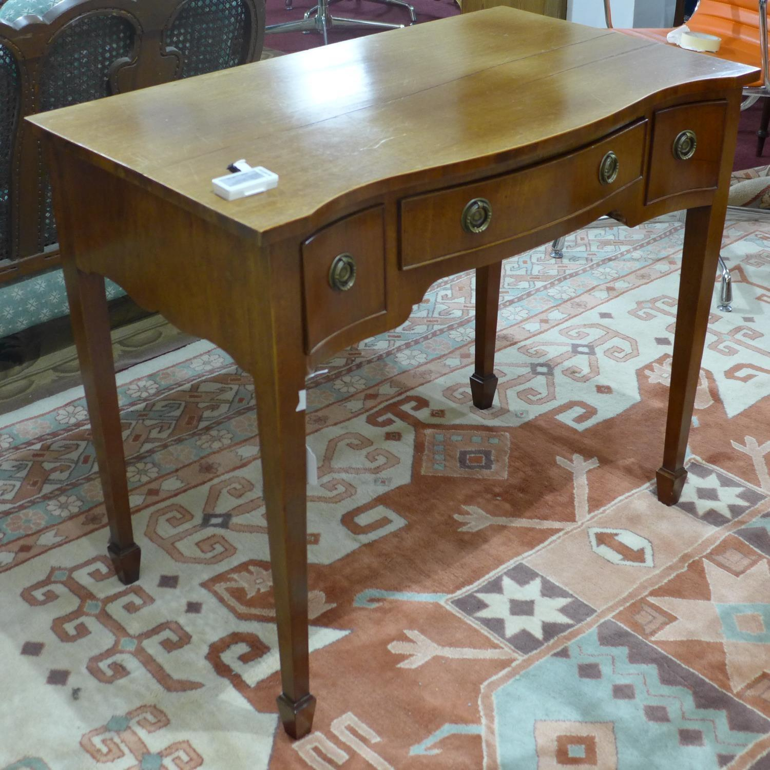 Lot 228 - A small early 20th century desk on tapered legs