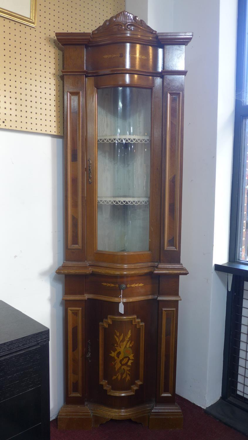 Lot 143 - An Italian marquetry serpentine corner display cabinet, glazed door above cupboard, with floral