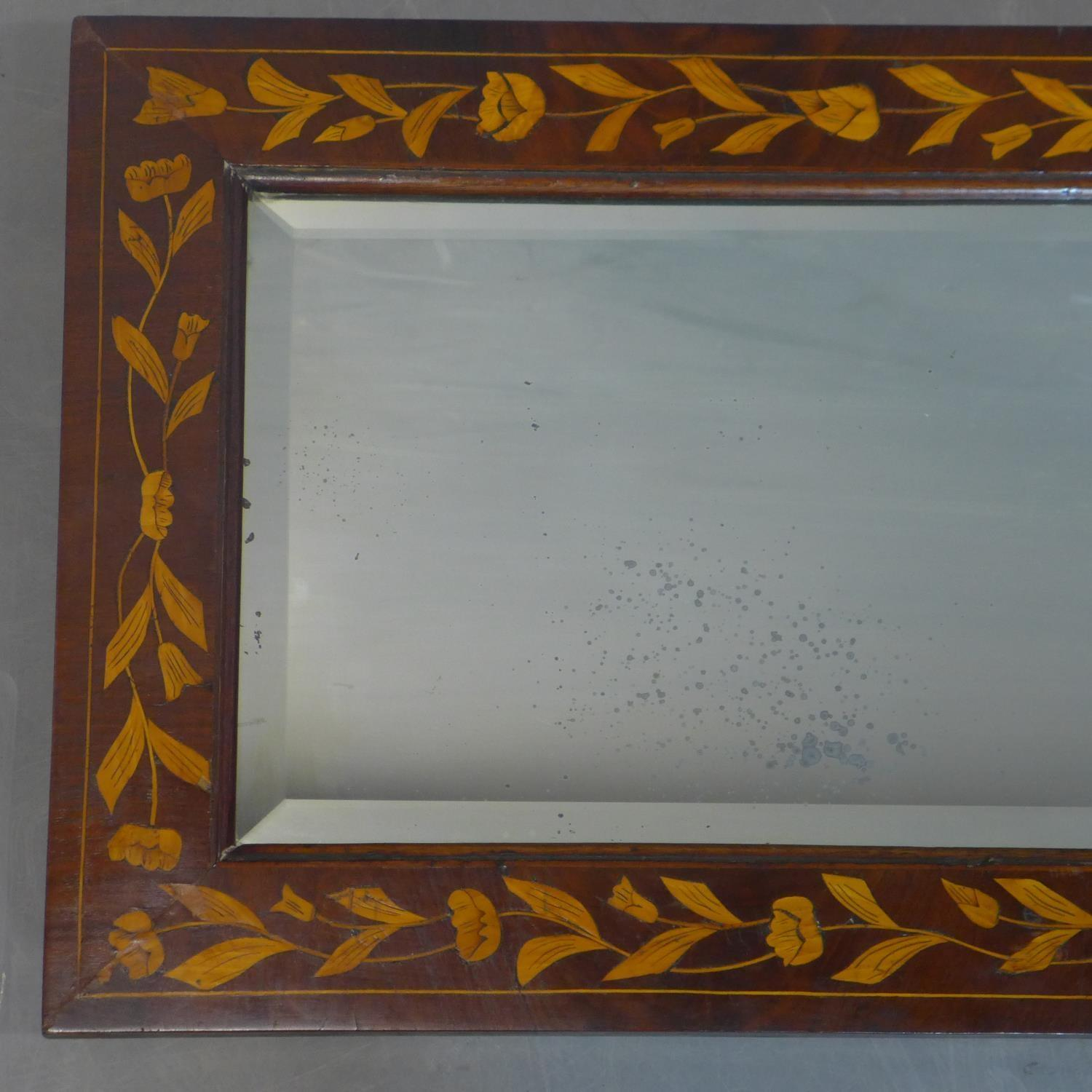 Lot 100 - A late 19th or early 20th century Dutch marquetry inlaid mahogany wall mirror, inlaid with
