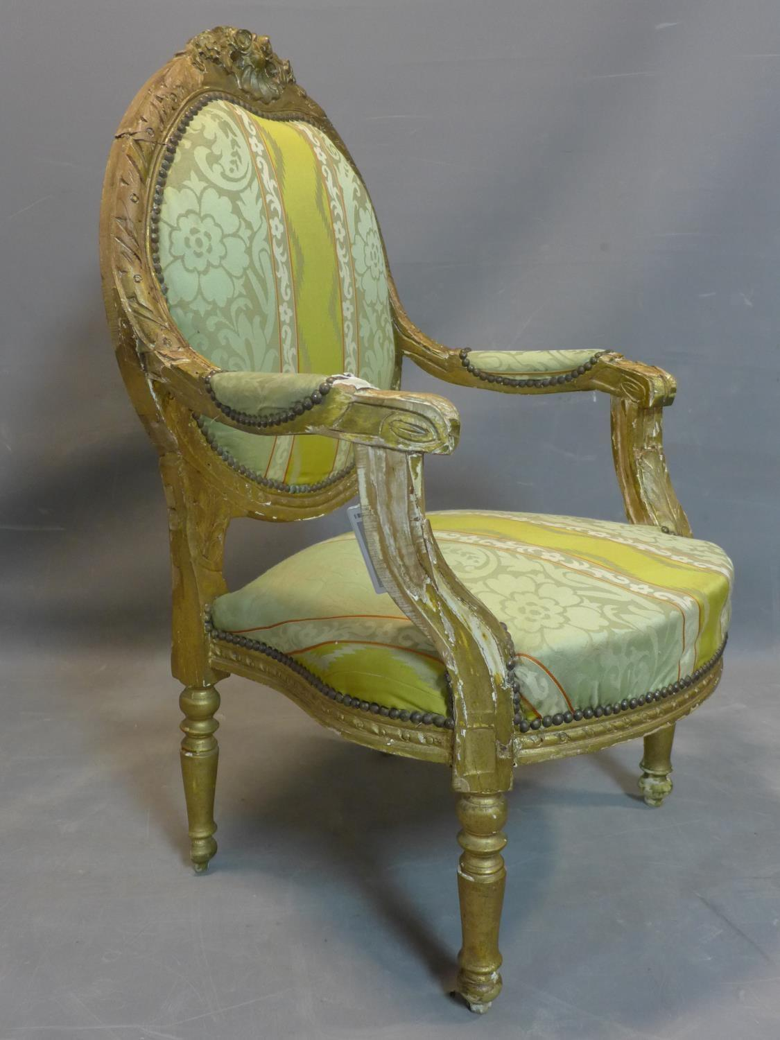 Lot 82 - A 19th century French Louis XVI style fauteuil armchair, with striped floral upholstery, carved
