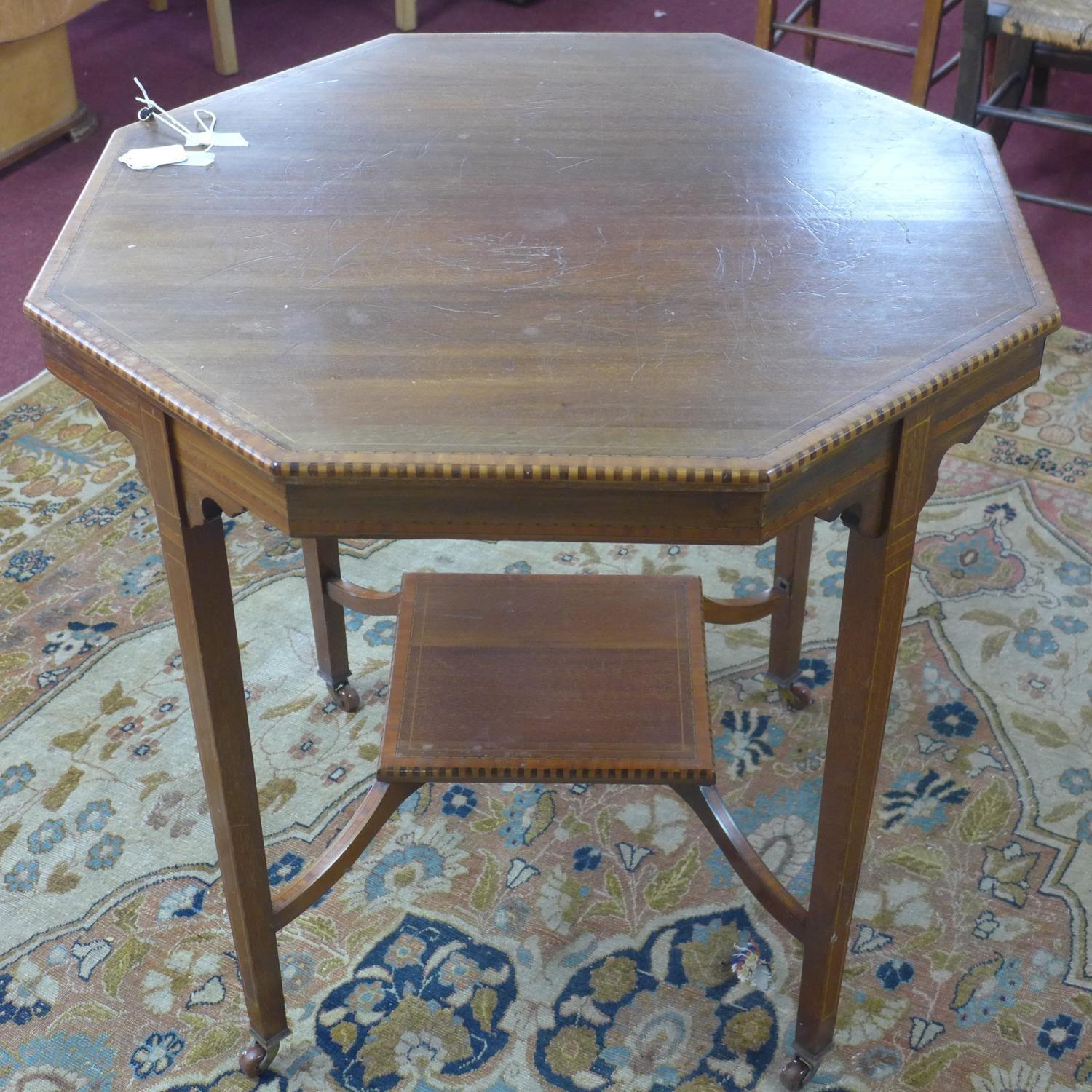 Lot 152 - An Edwardian mahogany octagonal inlaid occasional table, with undertier, raised on tapering legs and