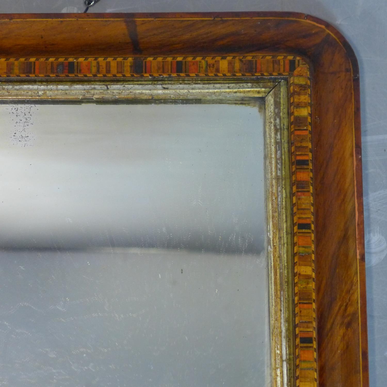 Lot 178 - An inlaid walnut overmantle mirror, raised on ceramic ball feet, 44 x 71cm