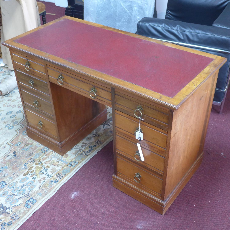 Lot 154 - A Victorian pedestal desk with leather skiver, having an arrangement of nine drawers, on pedestal