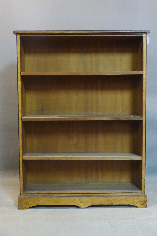 Lot 248 - An Edwardian mahogany open bookcase, with ebonised edges, raised on pedestal base and bracket feet