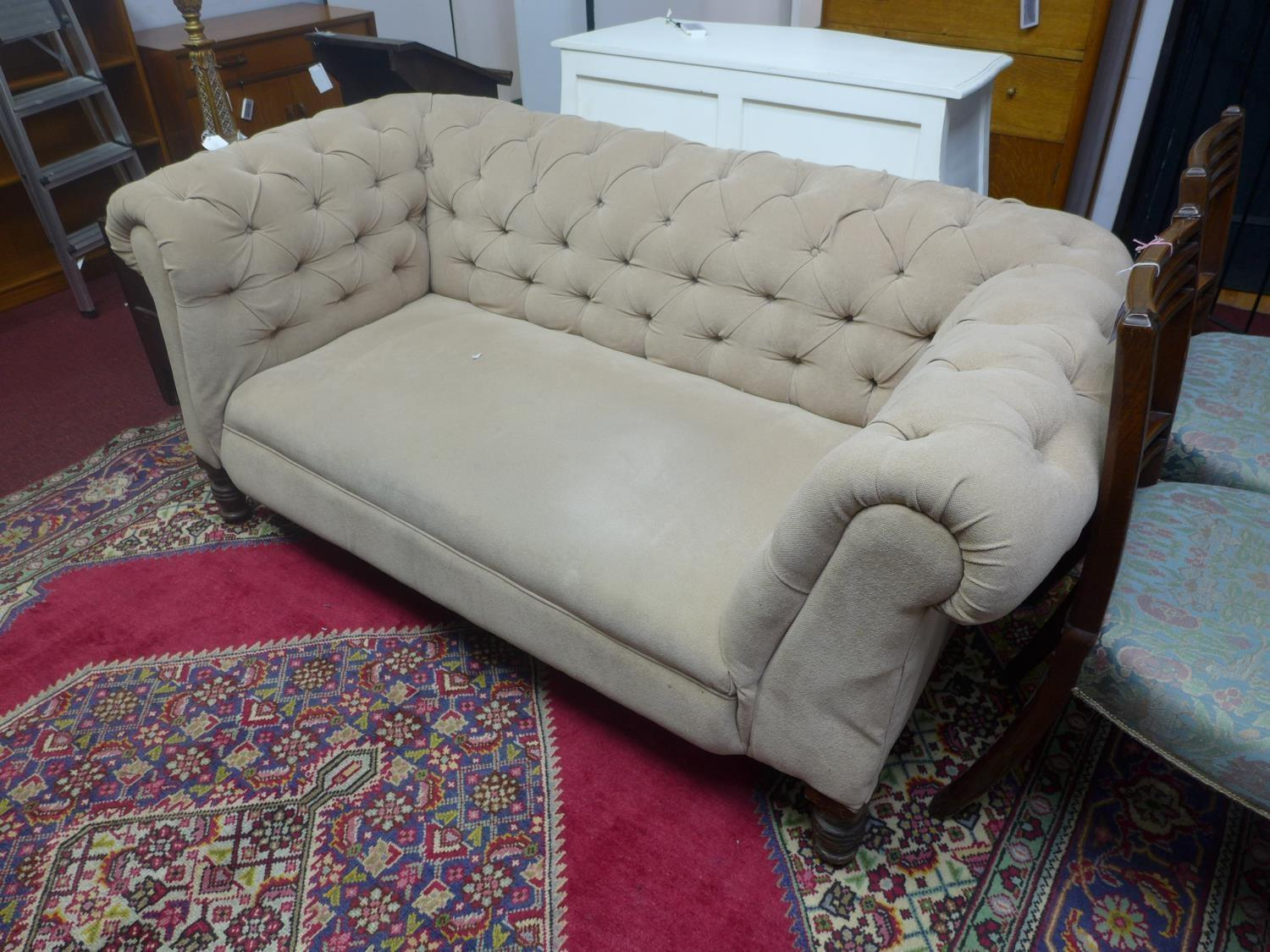 Lot 188 - A Chesterfield sofa with button back upholstery, on turned legs, H.70 W.165 D.88cm