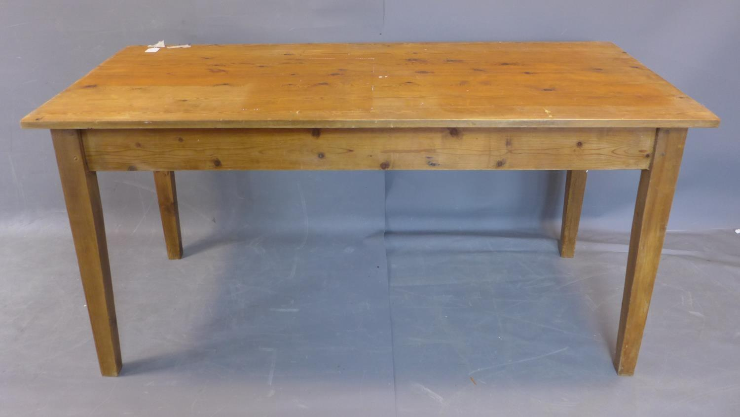 Lot 60 - A pine kitchen table, on square tapered legs, H.76 W.158 D.77cm