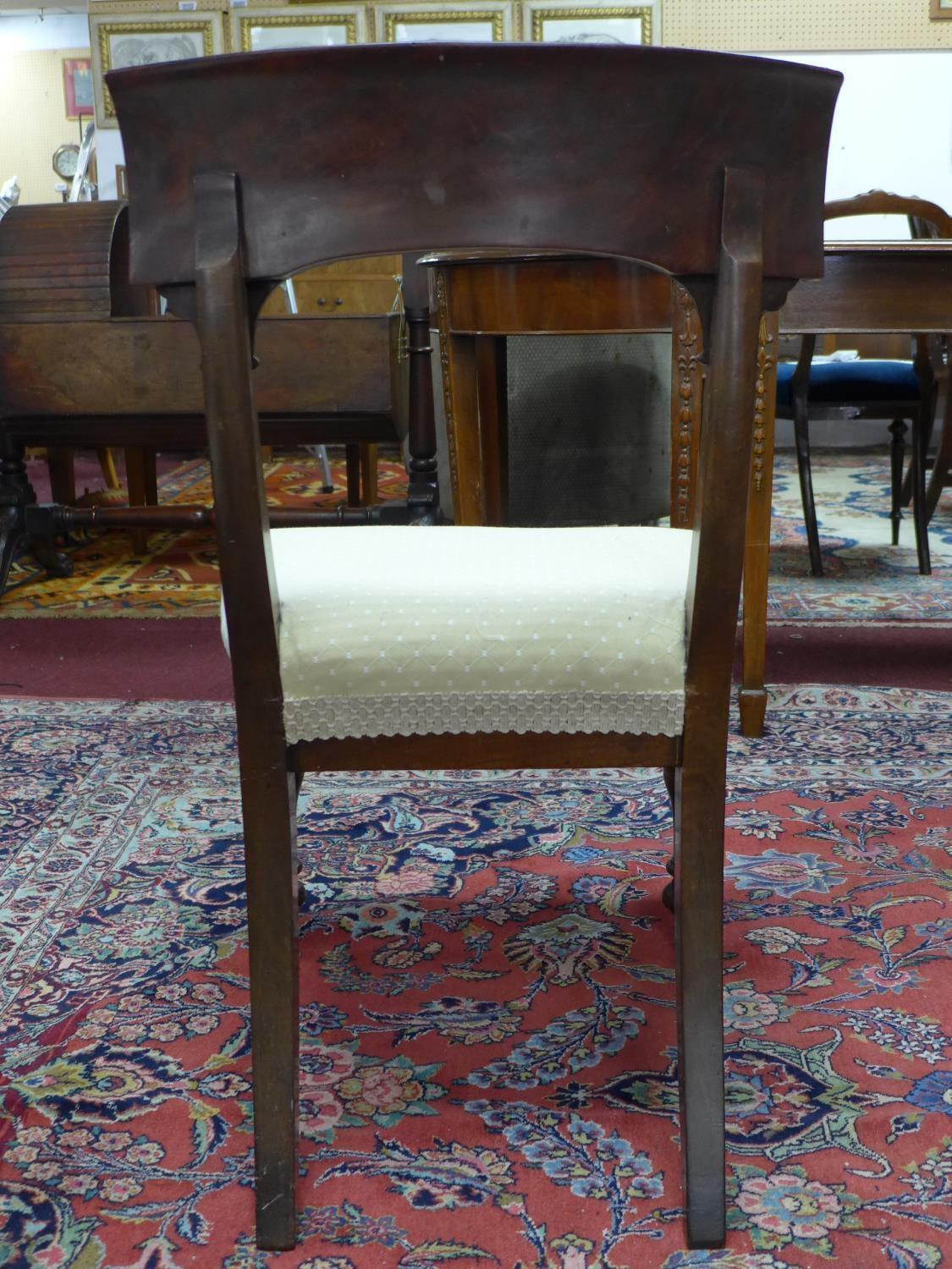 Lot 157 - A set of four mahogany William IV dining chairs, with cream upholstered seats, on turned legs, label