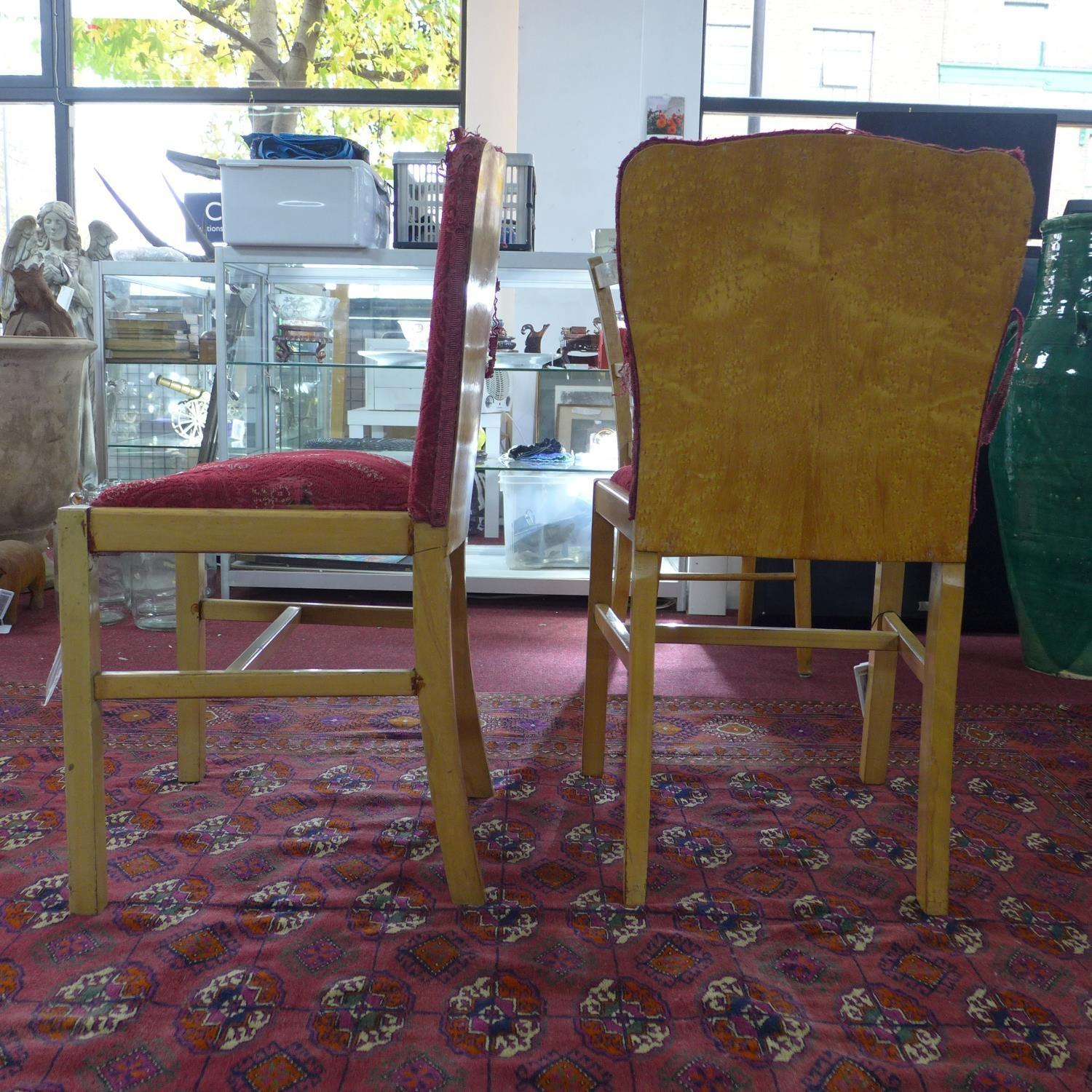 Lot 150 - A set of four Art Deco burr walnut dining chairs, with red floral upholstery, on square legs