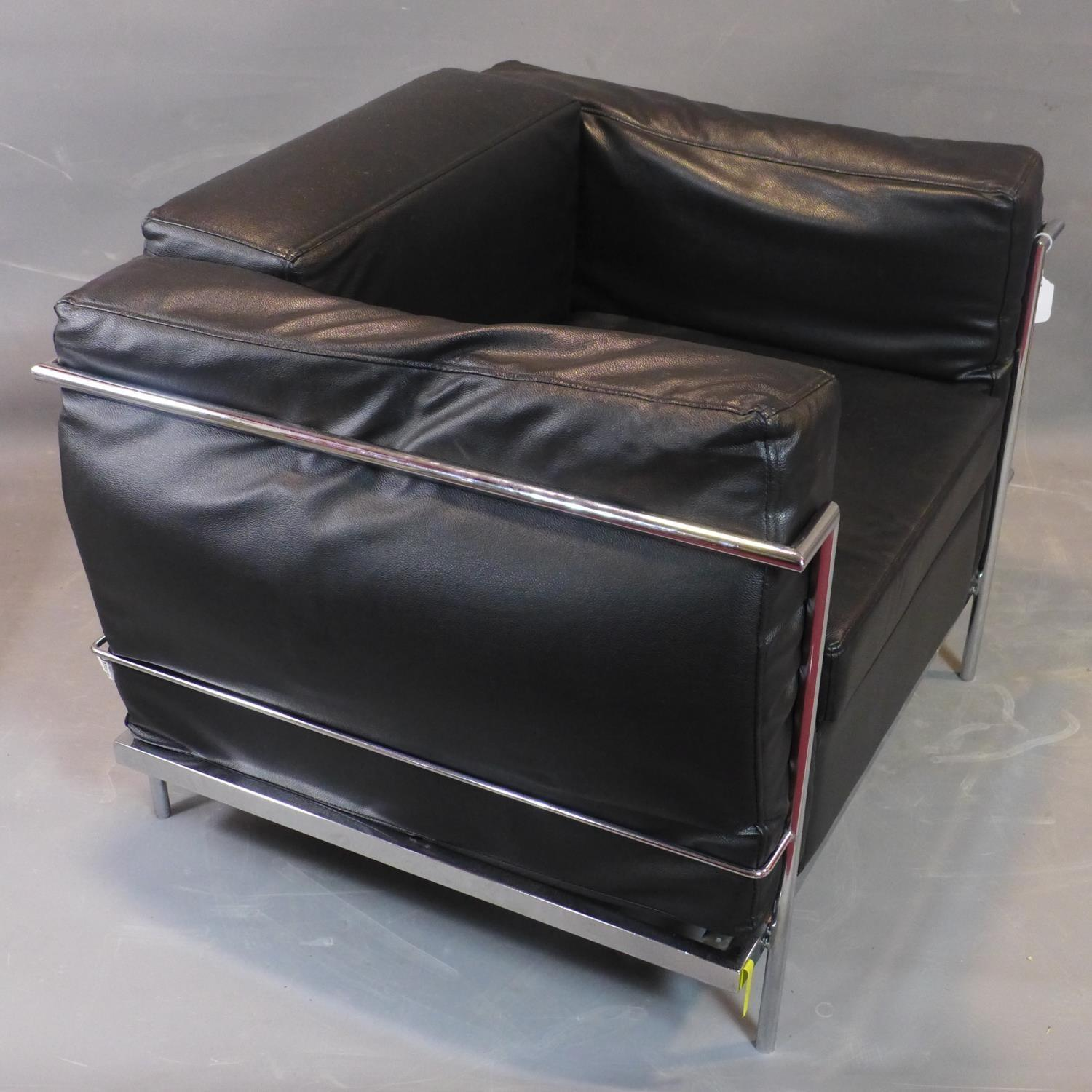 Lot 255 - A Le Corbusier style chrome and black leather sofa, with label for Amax, H.72 W.90 D.76cm