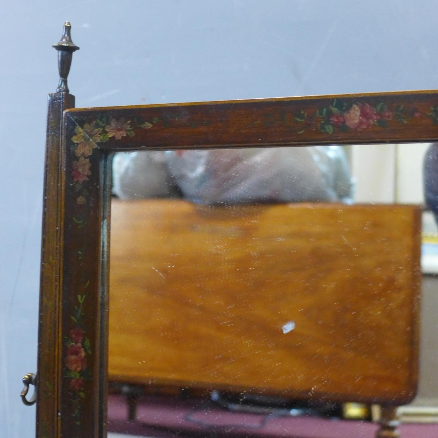 Lot 176 - A toilet mirror painted with cherub and flowers, having three drawers, raised on bracket feet, H.