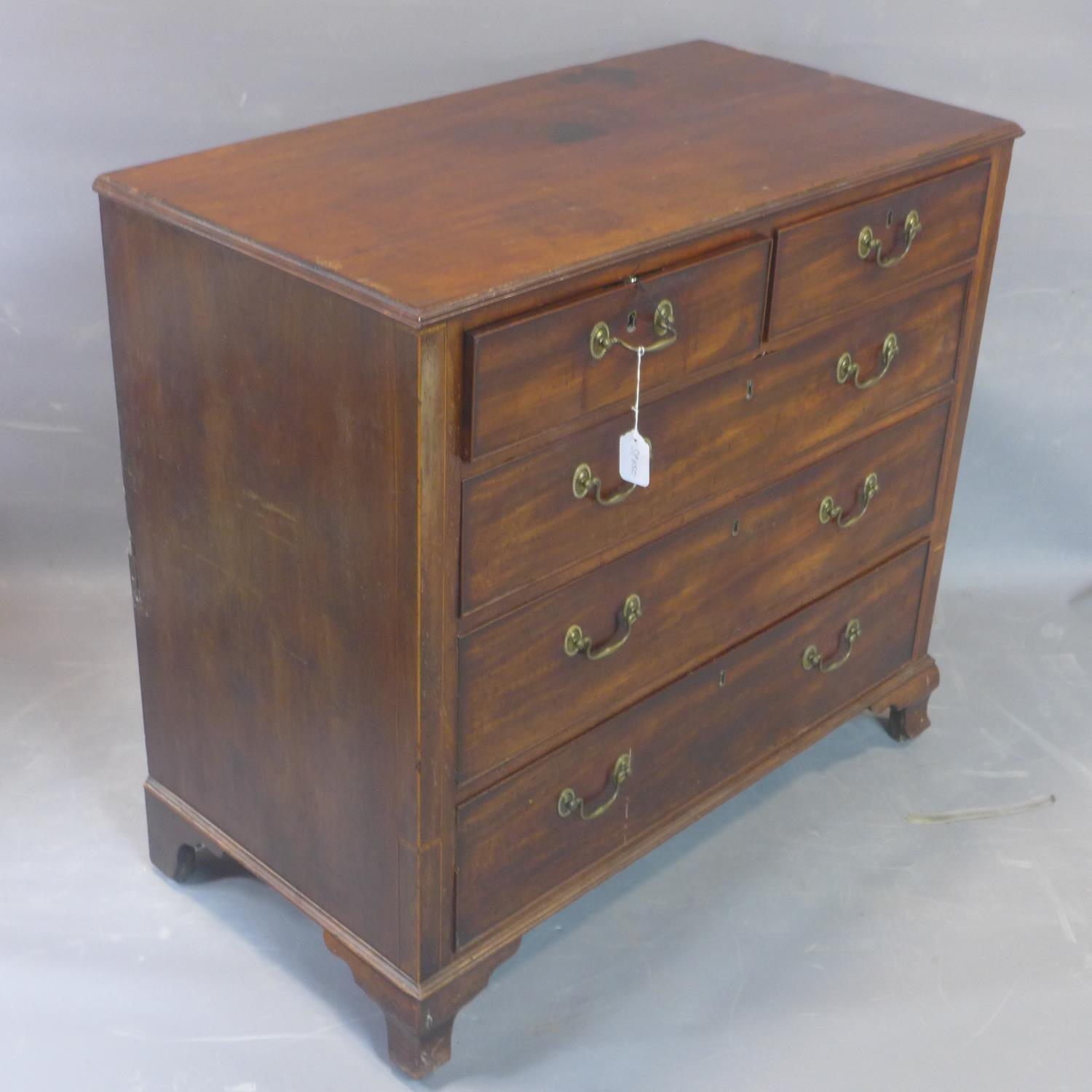Lot 209 - A 19th century mahogany chest of two short over three graduated long drawers, on bracket feet, H.
