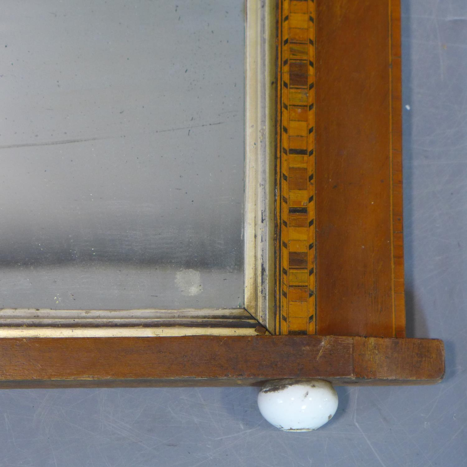 Lot 173 - An inlaid overmantle mirror with original glass plate, on ceramic ball feet, 49 x 85cm