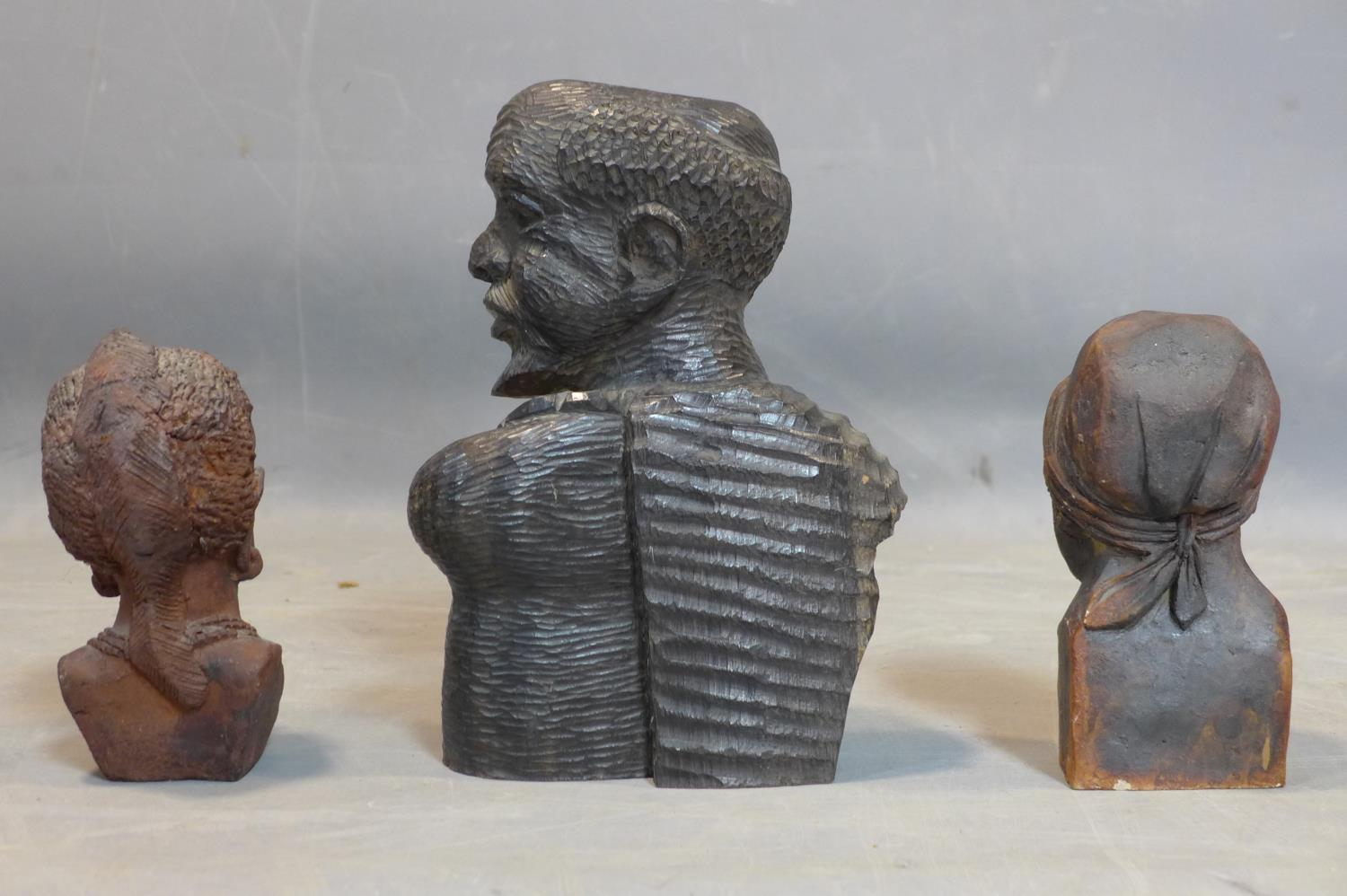 Lot 93 - A collection of African figures, to include a carved hardwood head and shoulder bust of a man, H.