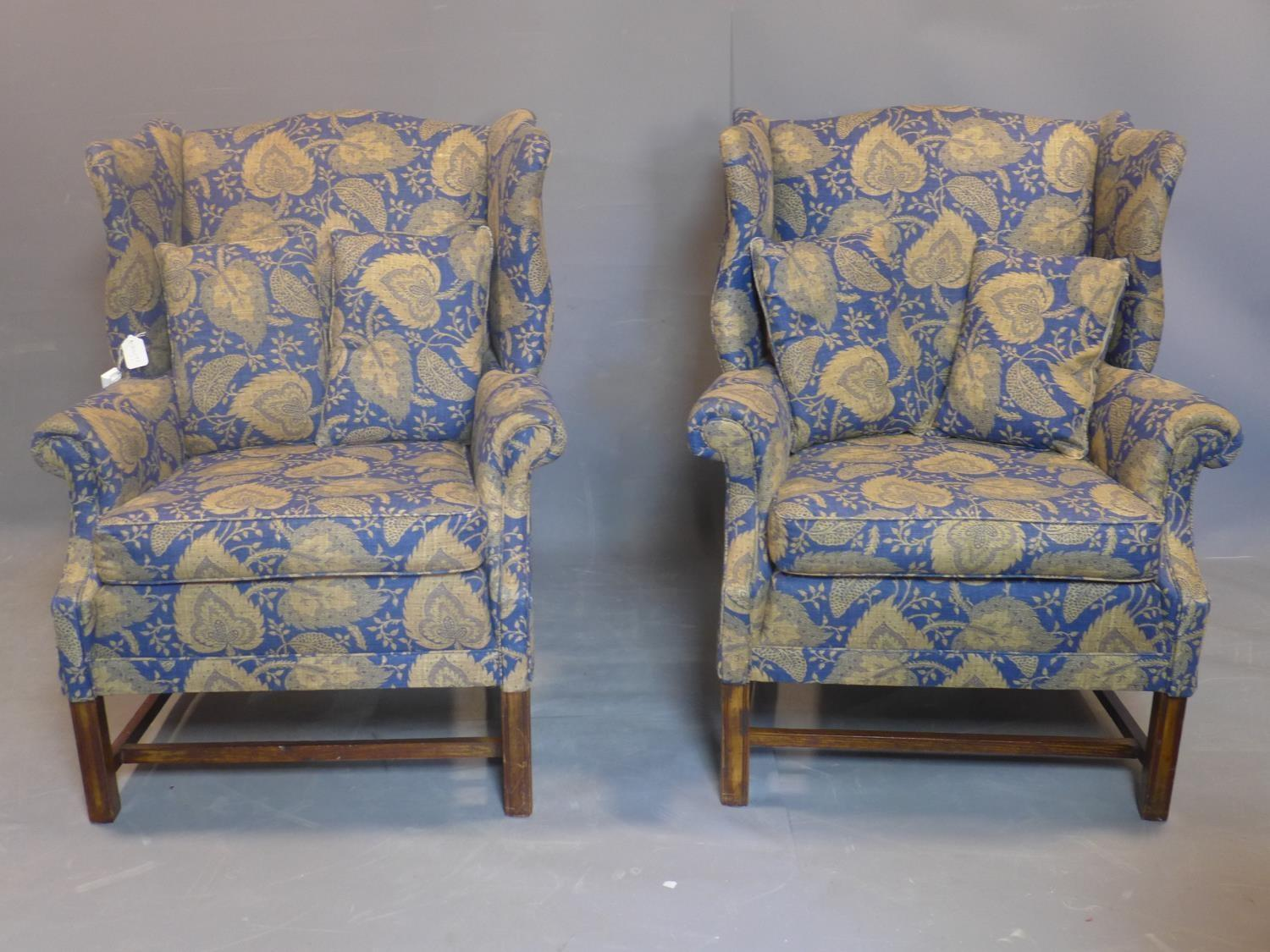 Lot 103 - A pair of 20th century wingback armchairs, with Jane Churchill Limited designer fabric, on square