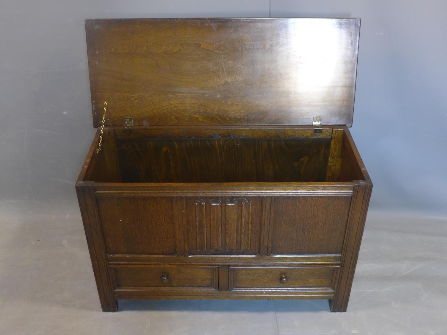 Lot 108 - An early 20th century oak mule chest, with hinged lid above two short drawers, on square reeded