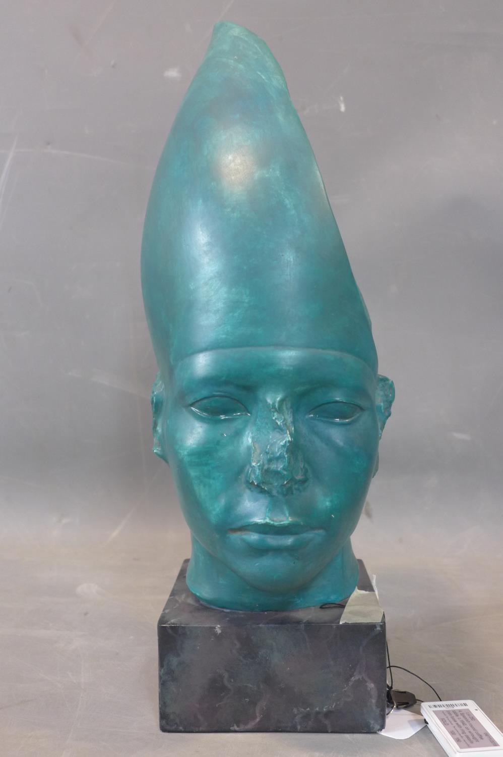 Lot 91 - A turquoise cast plaster Egyptian style head, indistinctly signed to reverse, on faux marble cast
