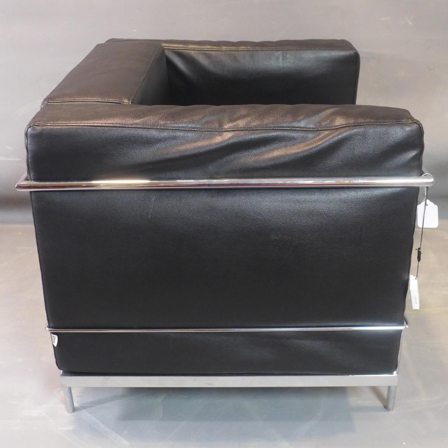 Lot 256 - A Le Corbusier style chrome and black leather sofa, with label for Amax, H.72 W.90 D.76cm