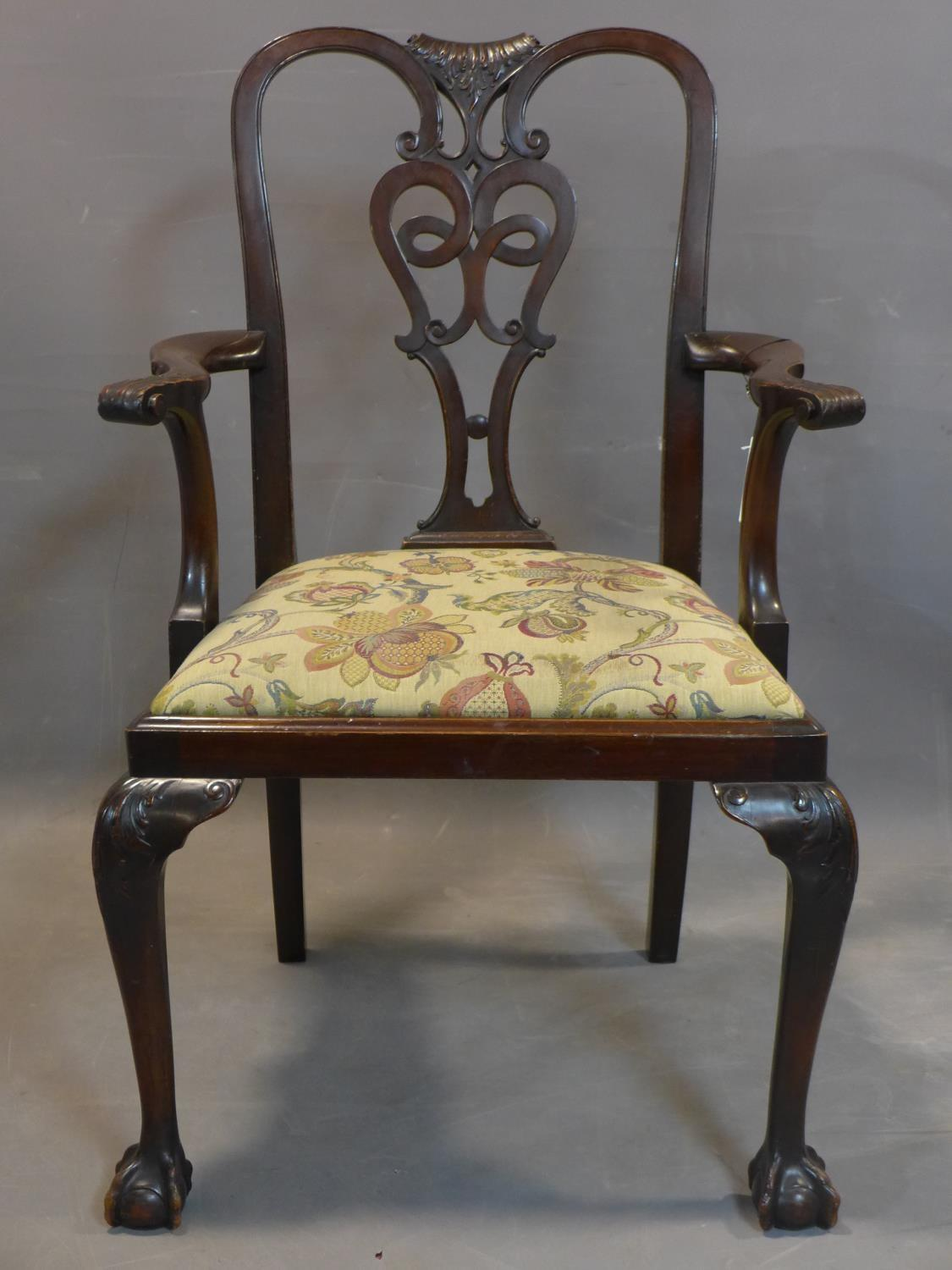 Lot 214 - 19th century mahogany Chippendale style hallway armchair, with drop-in seat and scroll arms,