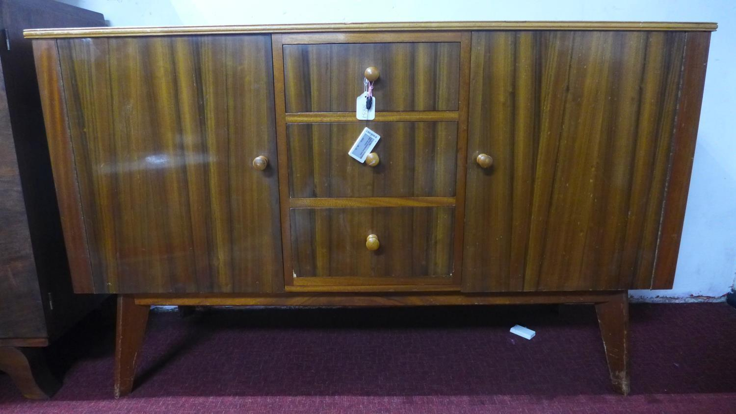 Lot 272 - A 20th century walnut Cumbrae by Morris of Glasgow sideboard, with maker's mark, having three