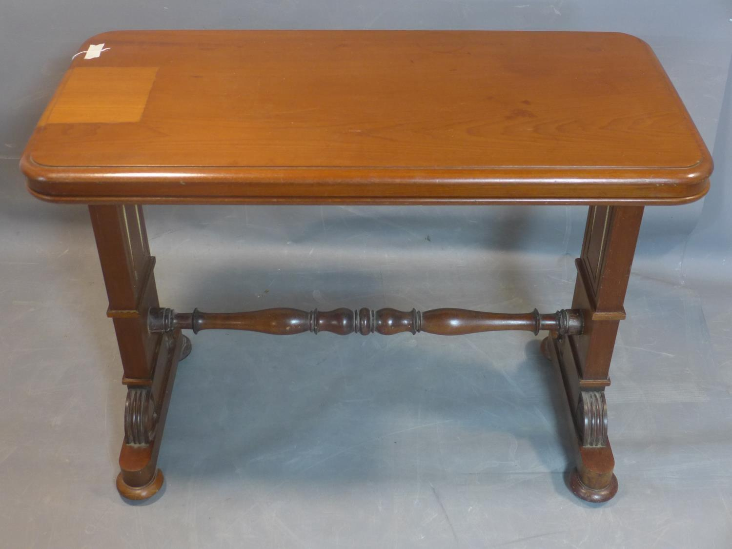 Lot 119 - A 19th century mahogany three tier metamorphic buffet, on carved supports joined by turned