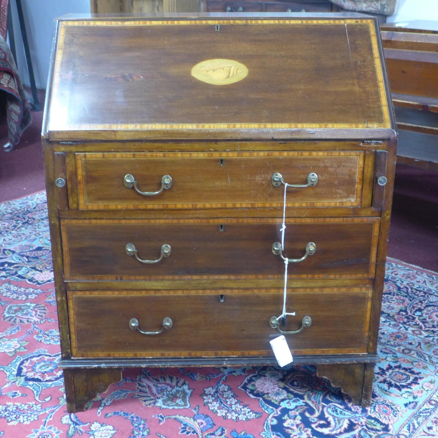 Lot 156 - An Edwardian Sheraton Revival inlaid mahogany bureau, with shell paterae to slope, having fitted