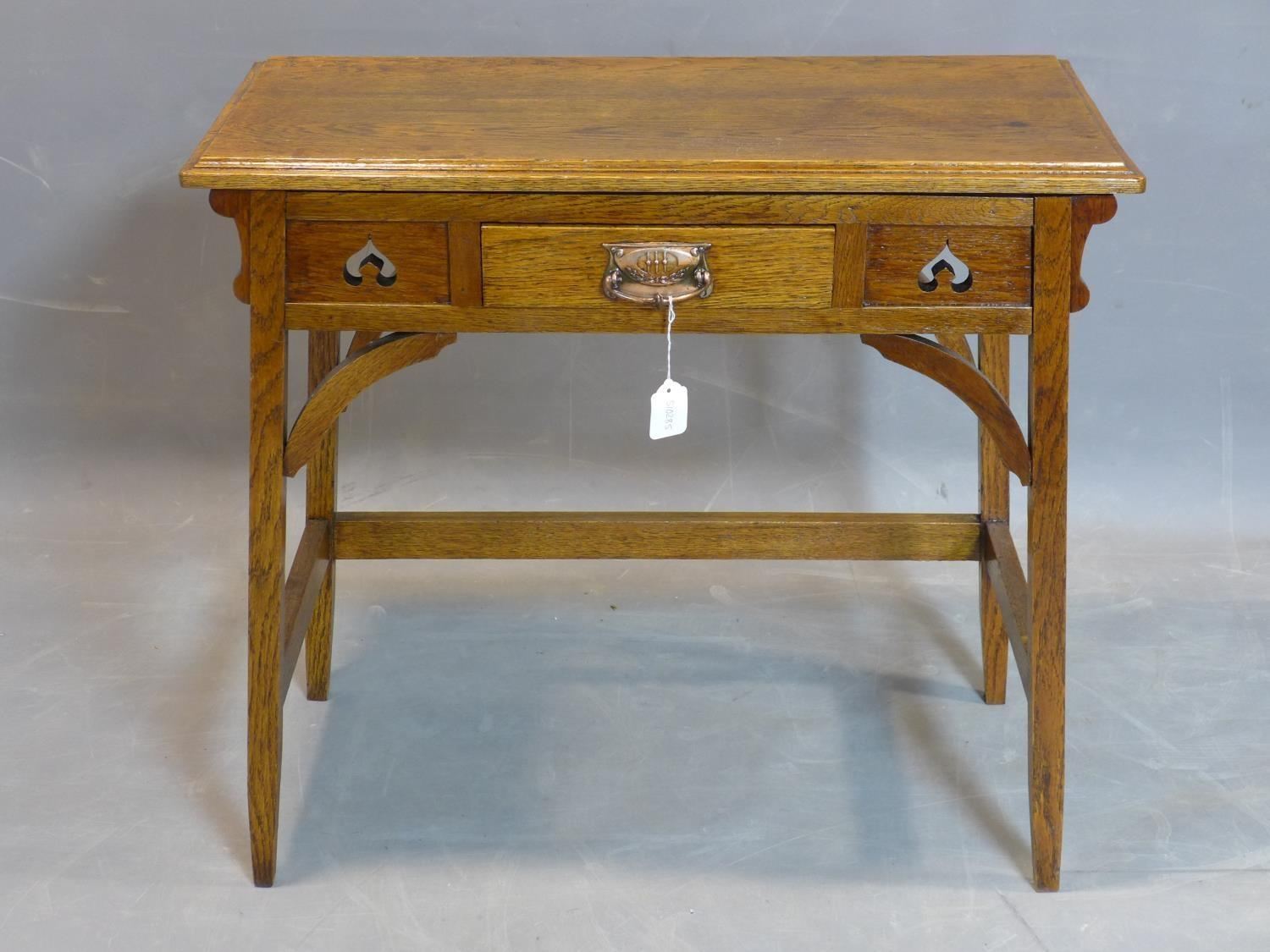 Lot 114 - An Arts and Crafts oak side table, with central drawer, raised on square legs joined by