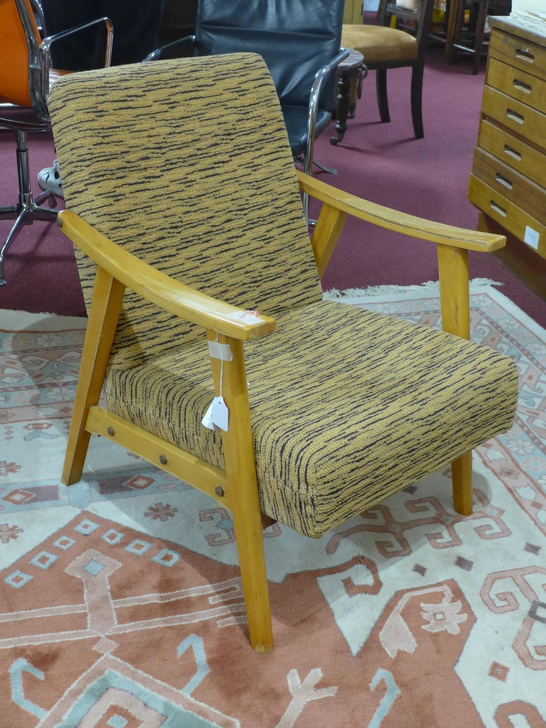 Lot 275 - A retro armchair with striped orange upholstery, H. 80 x W. 60 x D. 65 cm