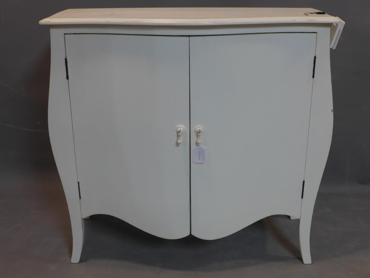Lot 75 - A French white painted serpentine cupboard, with two cupboard doors, on cabriole legs, H.84 W.90 D.