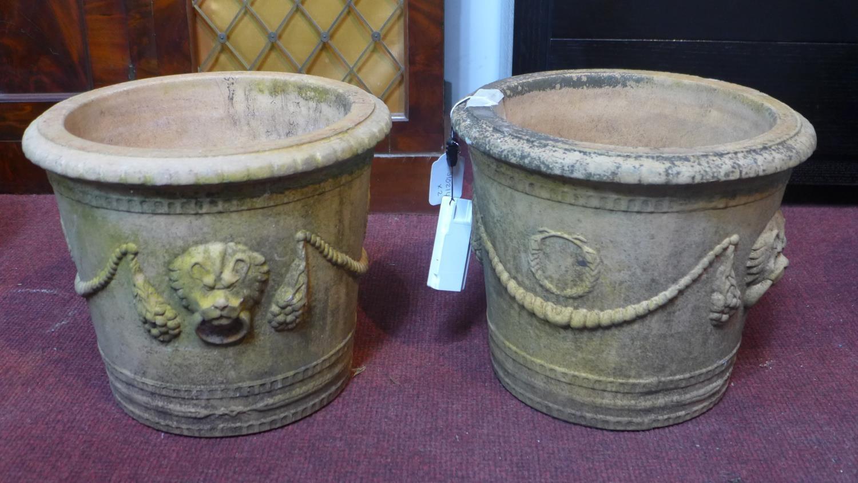 Lot 47 - Two stoneware pots with lion head decoration, H.27cm Diameter 53cm