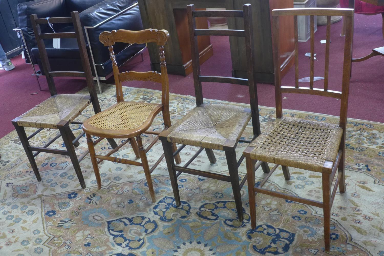 Lot 158 - Three early 20th century oak kitchen chairs, with rush seats, together with a bedroom chair with