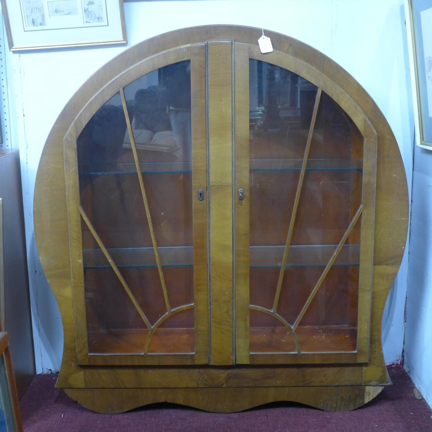 Lot 151 - A 1940's Art Deco style walnut circular glass fronted display cabinet, the astragal glazed doors