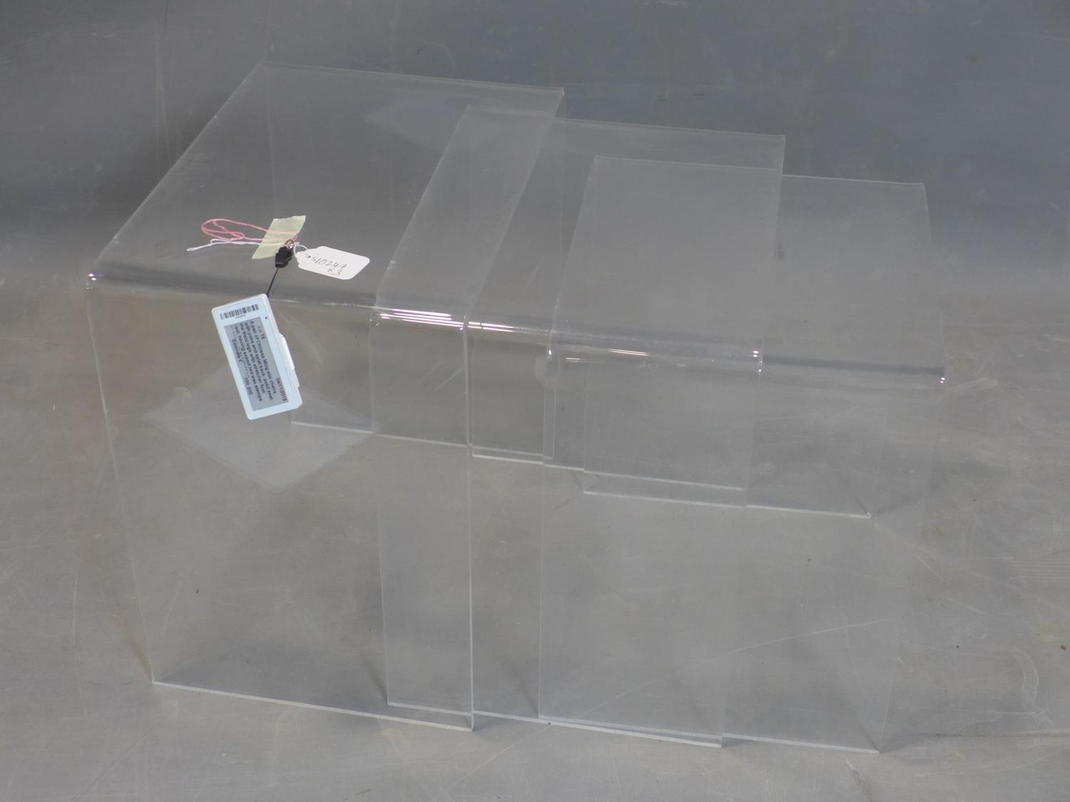 Lot 80 - A perspex nest of three tables, H.43 W.43 D.32cm (largest)