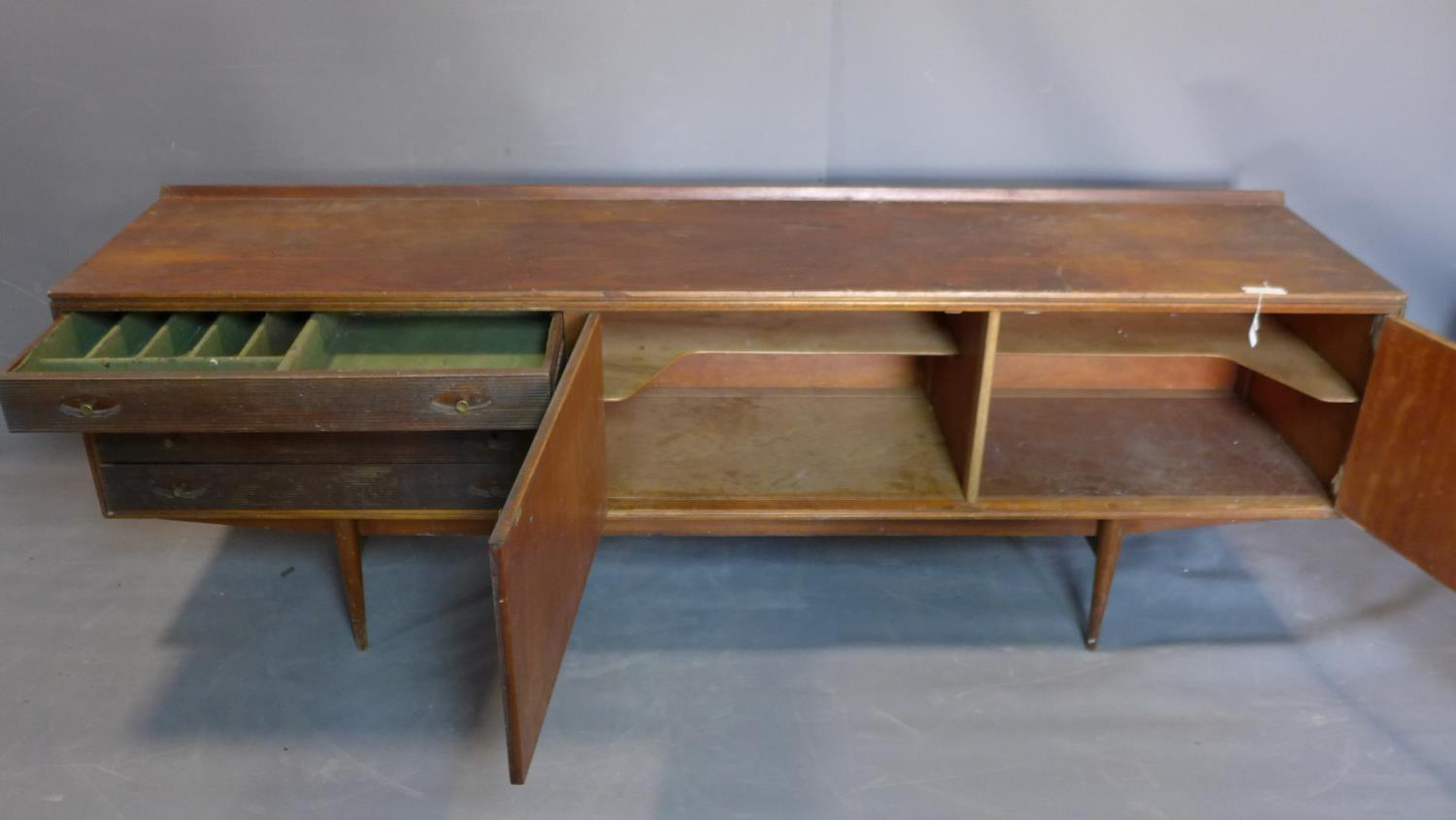 Lot 25 - A mid century teak sideboard designed by Robert Heritage (b.1927) for Archie Shine Ltd, c.1958, same