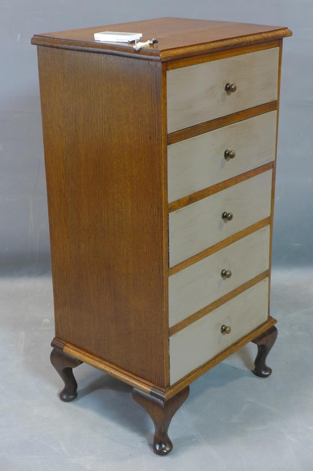 Lot 280 - An oak pedestal chest of five drawers, with grey painted drawers, on cabriole feet, H.91 W.45 D.36cm