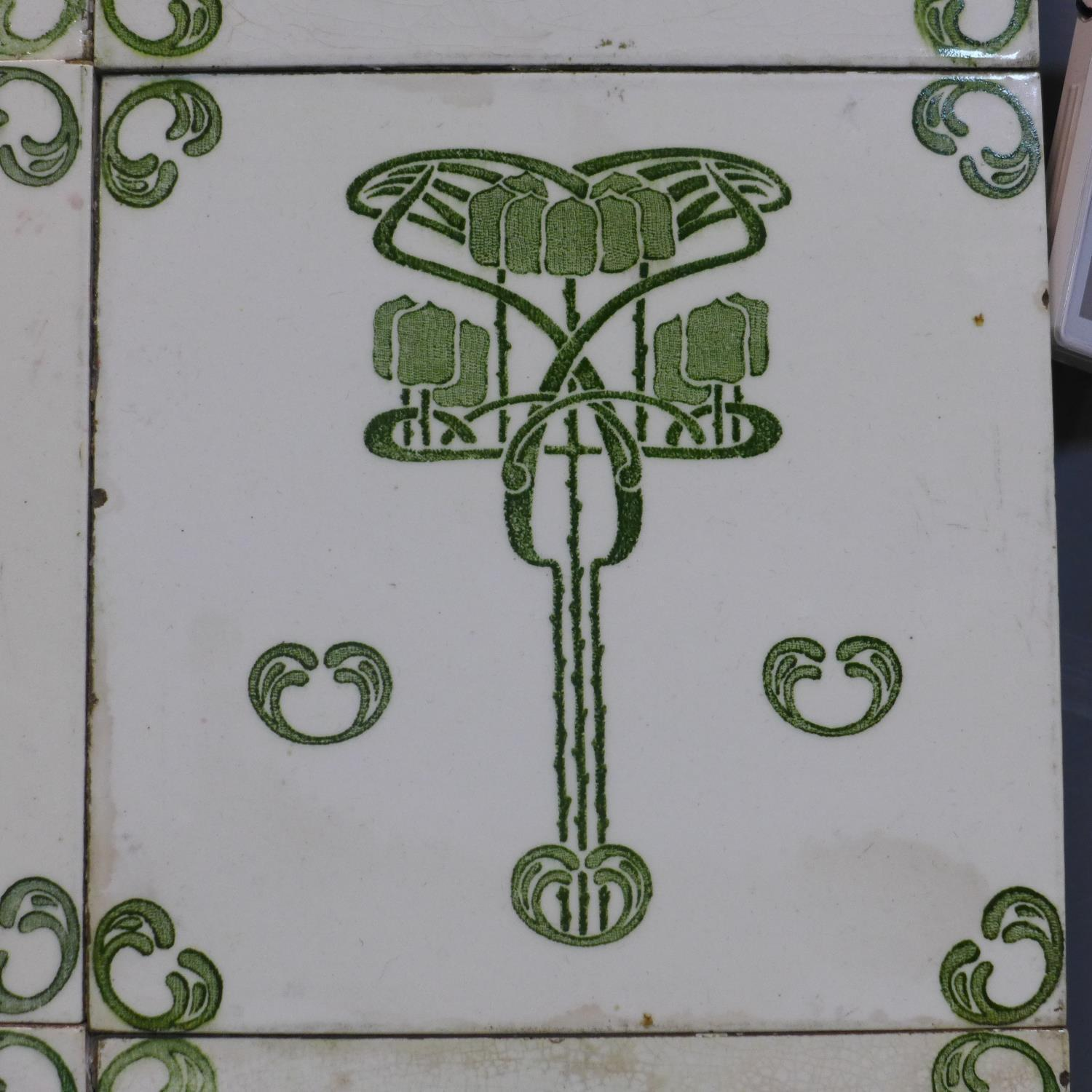 Lot 86 - A tray inlaid with Art Nouveau tiles