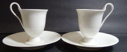 """2x Kaffee-Tassen mit U.T. """"KPM"""" Berlin weiss, H-11 cm,- - -22.61 % buyer's premium on the hammer"""